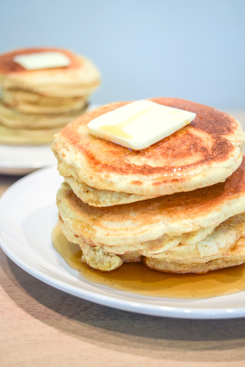 Trader Joe's Multigrain Pancake Mix stacks with butter and maple syrup from right side