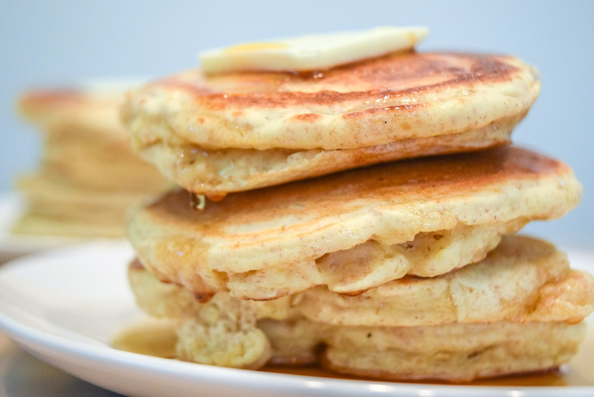 Trader Joe's Multigrain Pancake Mix stacks with butter and maple syrup up close
