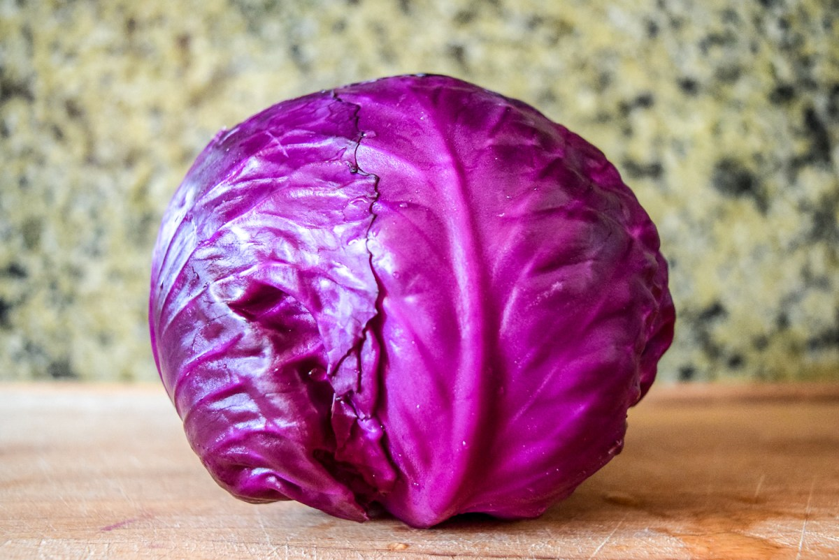 Red cabbage on wooden cuttingboard