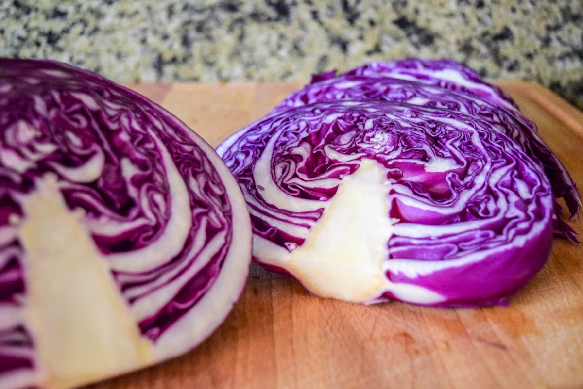 Sliced red cabbage on wooden cutting board