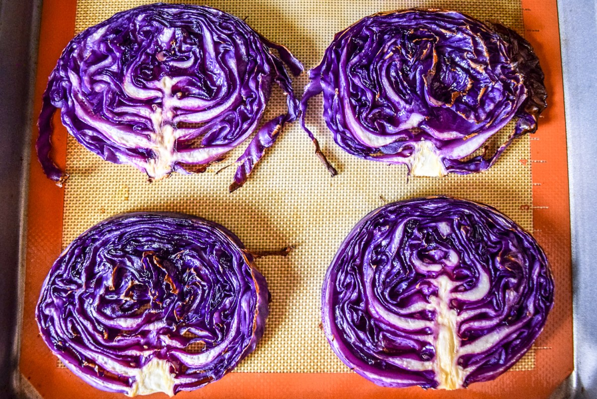 Roasted red cabbage steaks on sheet pan