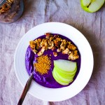Bluberry Chai Protein Smoothie Bowls topped with grain-free granola, apple, and bee pollen