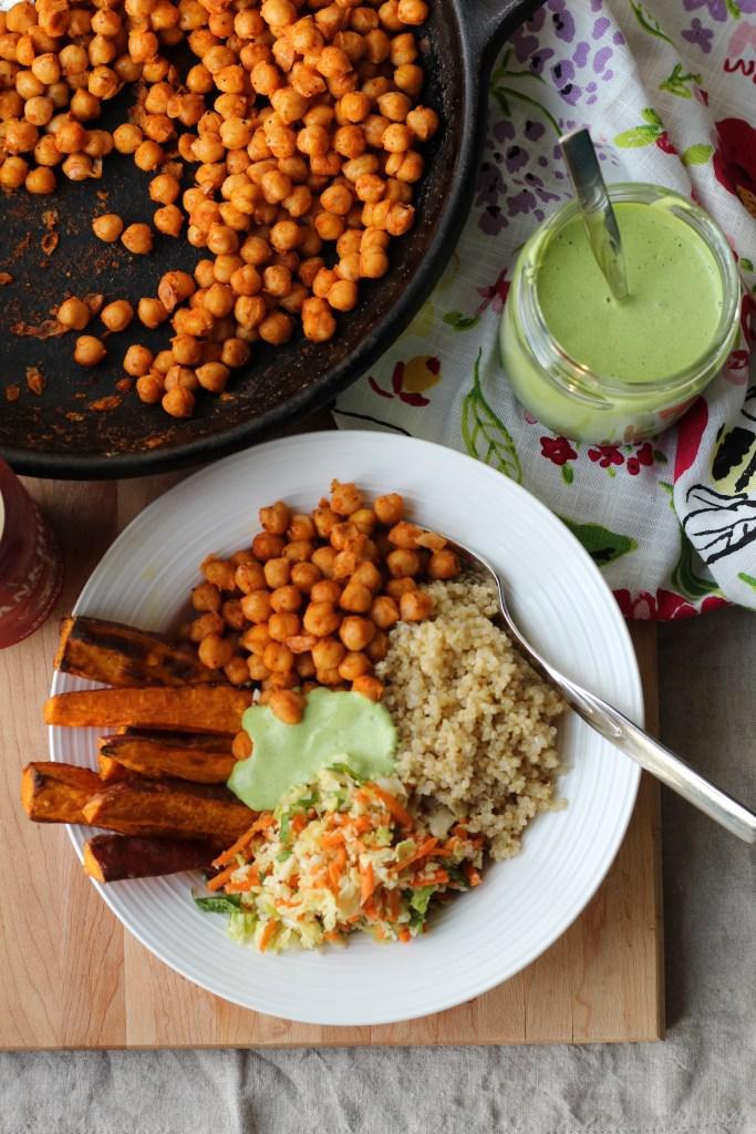Buffalo Chickpea Bowls with Quinoa, Sweet Potato, Slaw, and Cilantro Hemp Sauce