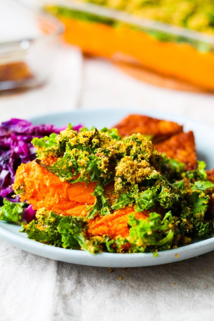 Healthy, vegan Sweet Potato Casserole with Crispy Kale and Pecan Parmesan