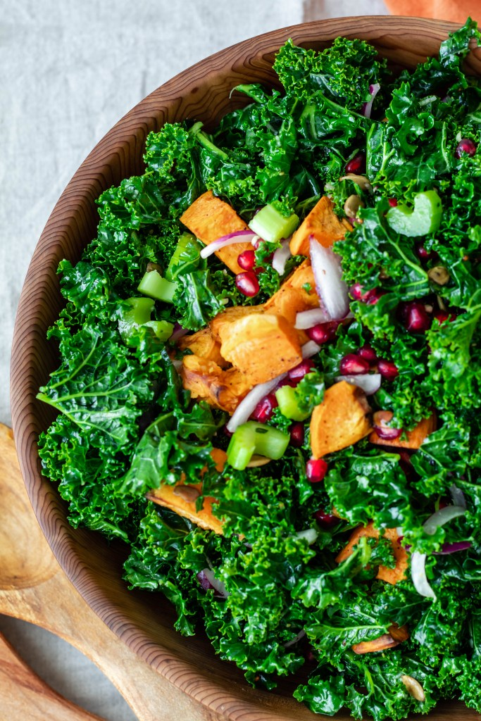 Festive Kale, Pomegranate, and Pepita Kale Salad with Sweet Potato