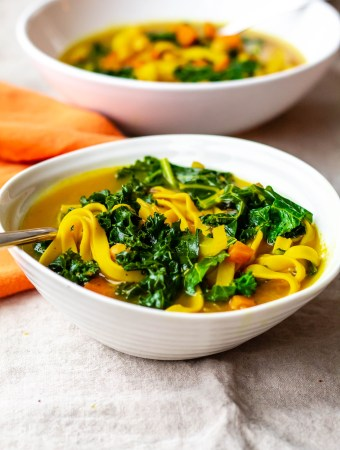 Healing chickpea noodle soup: Two bowls of this healthy vegan soup are shown in this photo.