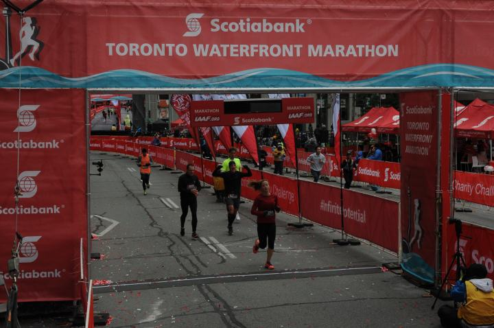 How I recovered from a decade-long battle with anorexia. This photo shows Allison of Up Beet Kitchen crossing the finish line of the Toronto marathon after recovering from anorexia.