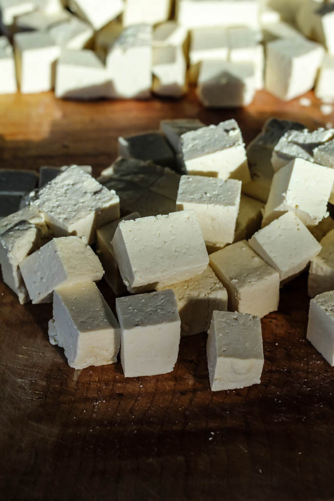 An image showing cubed tofu on a cutting board.