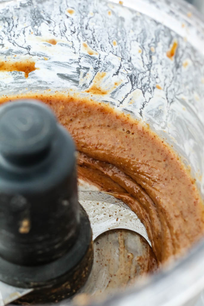 the frosting after being blended, still in the food processor. Looks like a brown caramel.