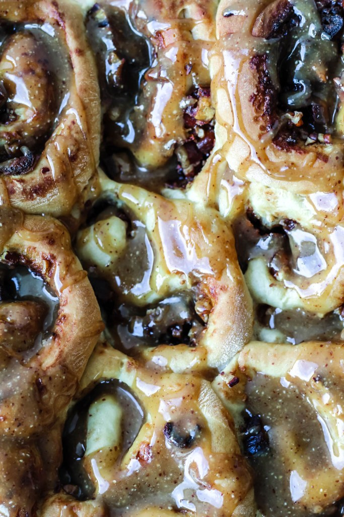 overhead close up of freshly glazed cinnamon buns