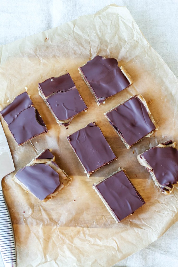 overhead shot of the caramel bars on a sheet of parchment paper