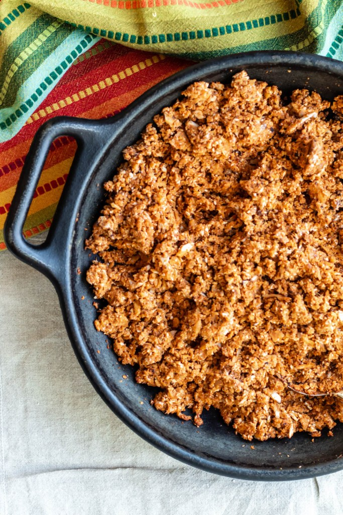 featured image for post showing overhead view of the taco meat in a cast iron skillet