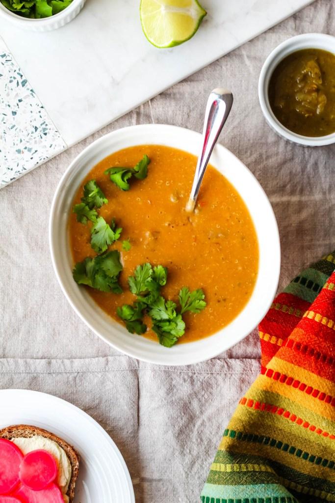 overhead shot of the quinoa white bean sweet potato soup in a bowl