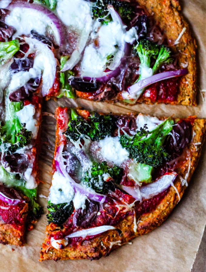 featured image of the post is a close up of a slice of pizza using the sweet potato pizza crust