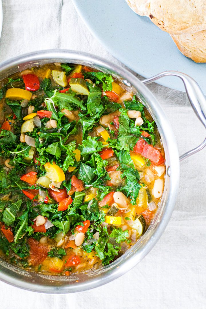 an overhead shot of the garden vegetable stew in a big pot