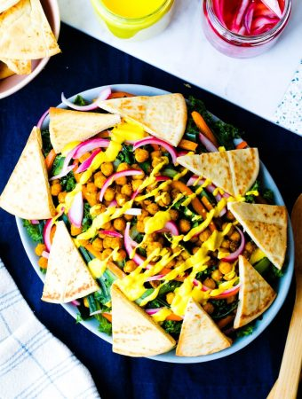 overhead shot of the chickpea kale salad on a large serving platter