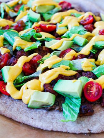 straight on shot of the pizza fully dressed and ready to eat