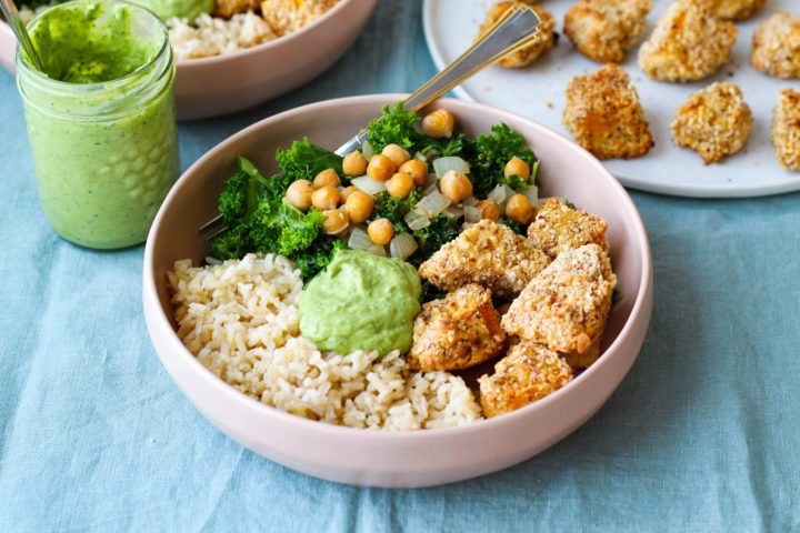 straight on shot of a quash, kale, rice, and chickpea bowl