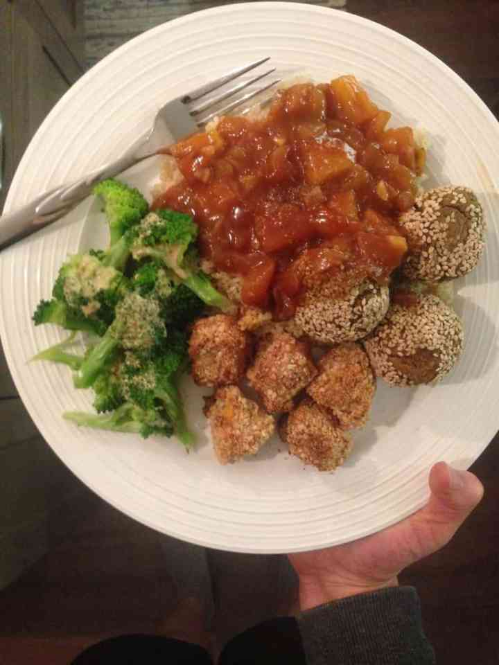 overhead shot of the plate of tempeh meatballs with sweet and sour sauce for dinner