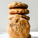 straight on shot of a stack of the cookies on a white plate