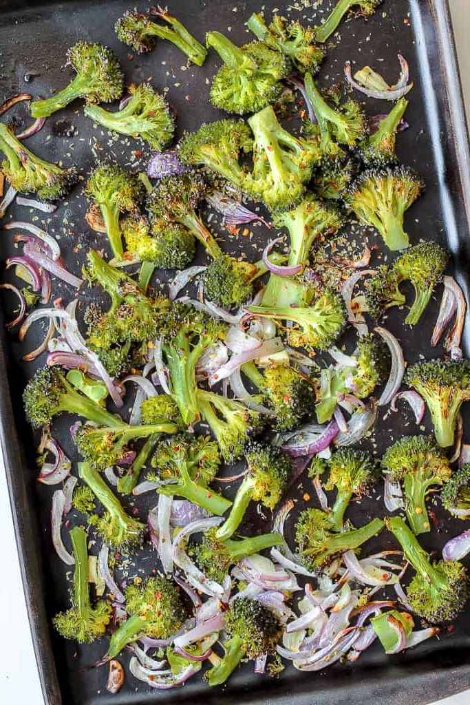 overhead shot of the roasted broccoli on a baking sheet
