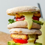 straight on shot of two of the tofu Benedict sandwiches with hemp hollandaise sauce dripping down