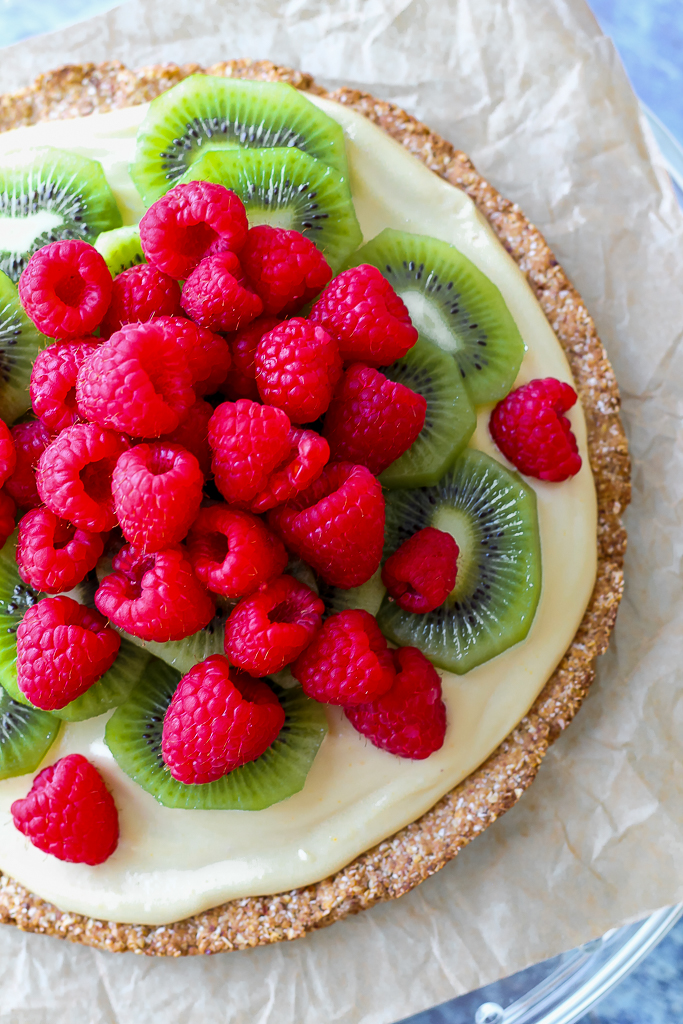 an overhead shot, close up, of the vegan fruit pizza on a cake plate