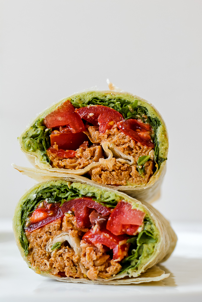 straight on shot of a beyond Italian sausage wrap on a white plate