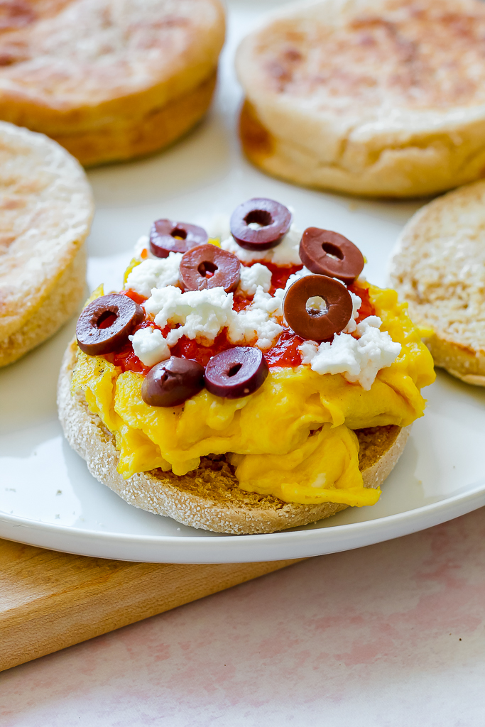 photo of half of the Moroccan breakfast sandwich with egg, harissa, feta, and olives