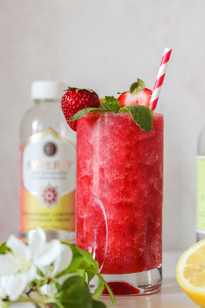 straight on shot of a glass of strawberry kombucha crush