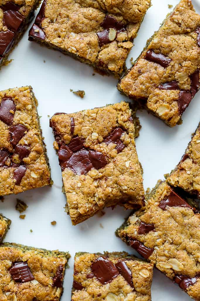 a close up overhead shot of the vegan chocolate chunk cookie bars on a white plate