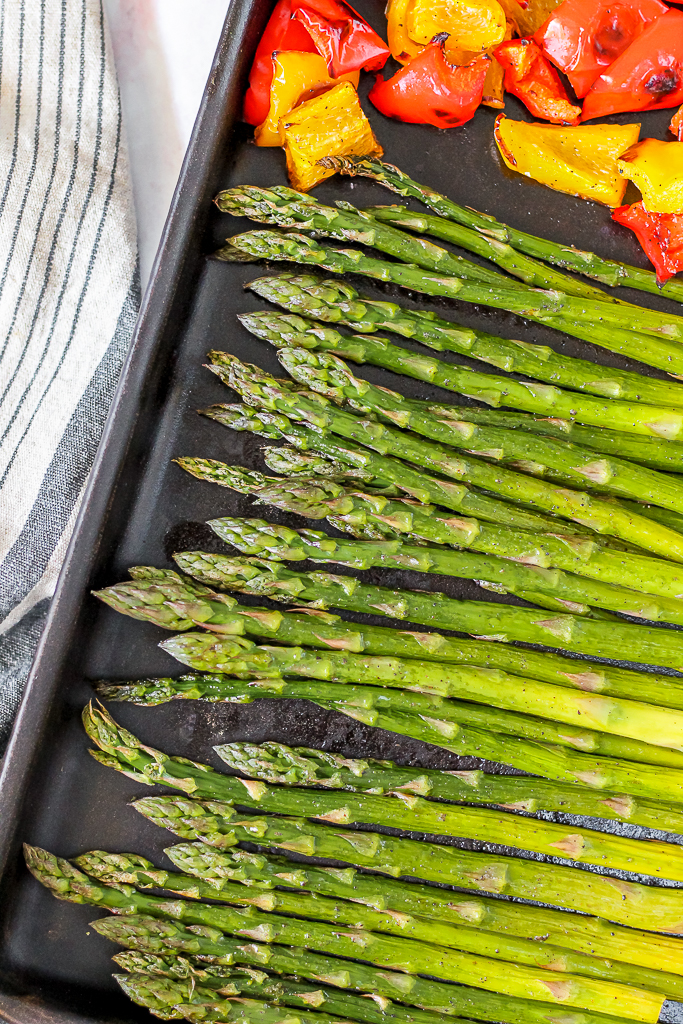 an overhead shot of the roasted asparagus and bell peppers on a cookie sheet