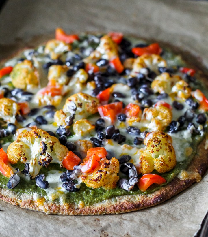 straight on shot of a chipotle cauliflower pizza, fresh out of the oven