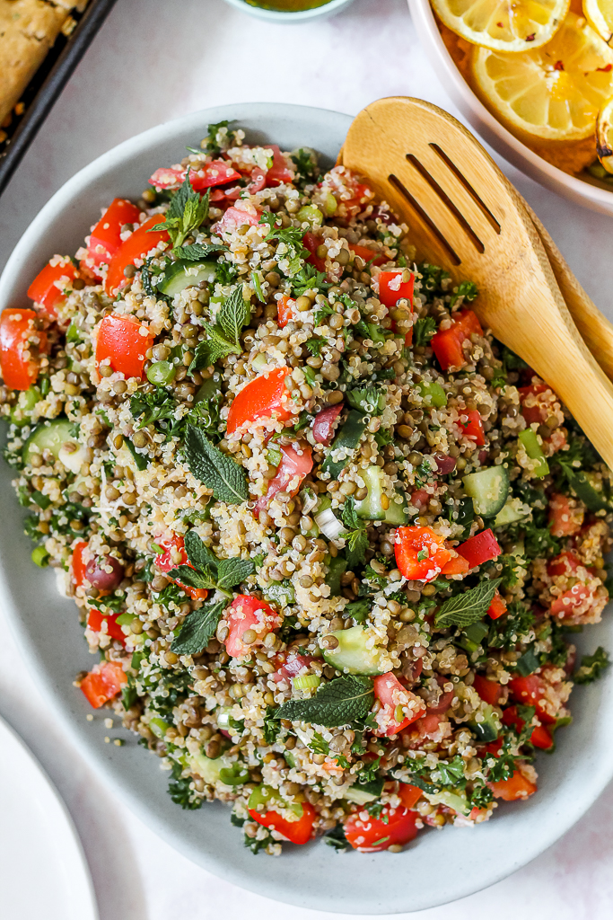 overhead photo of a platter heaped with lentil quinoa tabbouleh