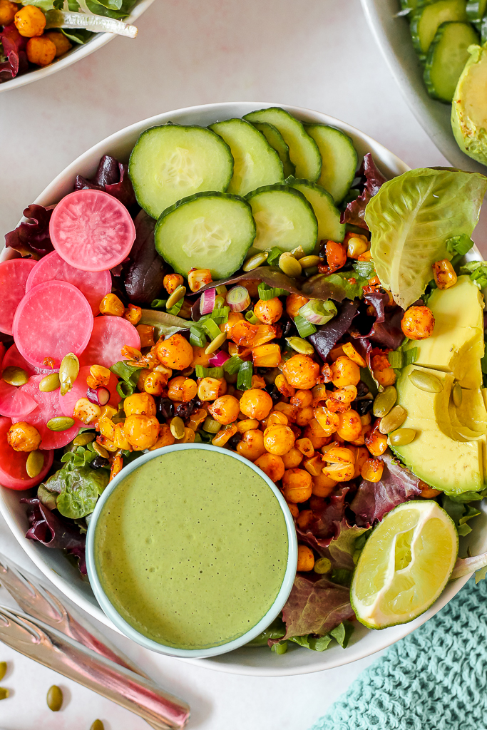 close up overhead shot of a bowl of the salad on a pink backdrop