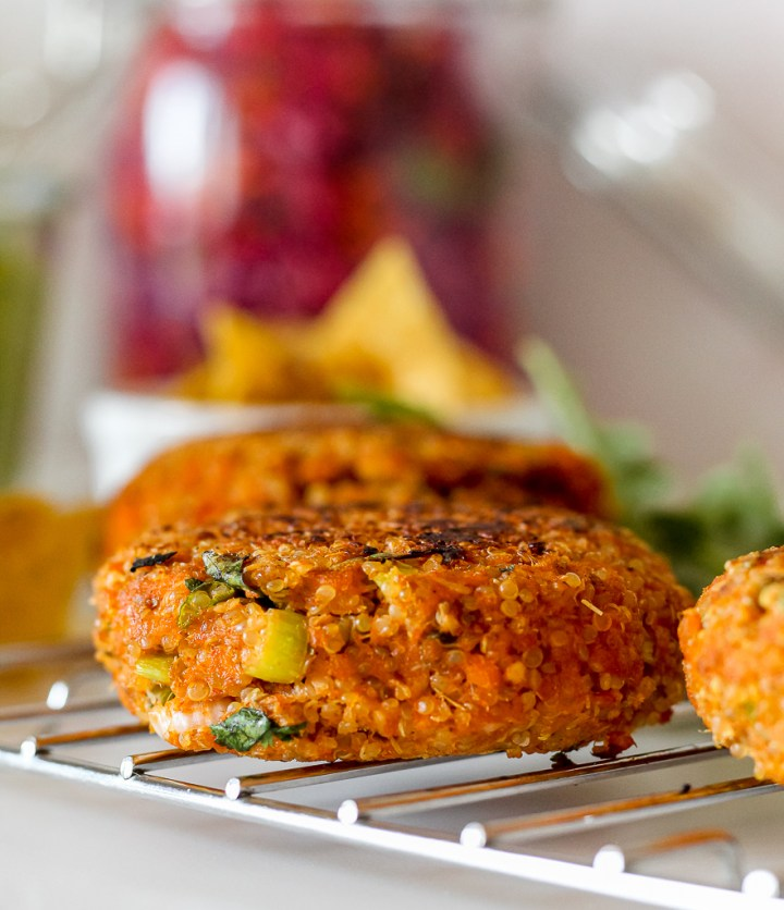 straight on shot of a salmon burger on a cooling rack