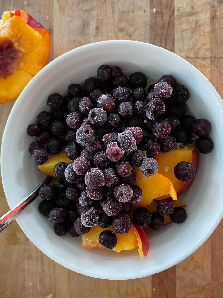 overhead photo of a fruit and yogurt bowl for breakfast