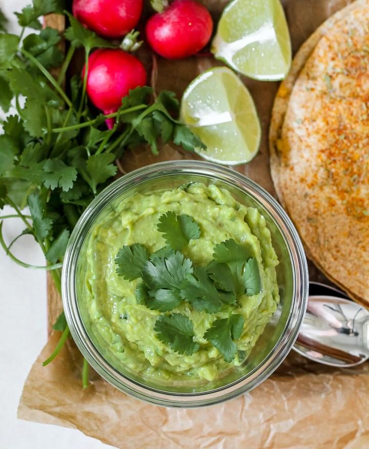 overhead shot of the guacamole in a jar