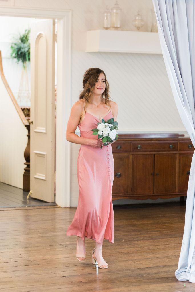 Allison walking at her brother's wedding