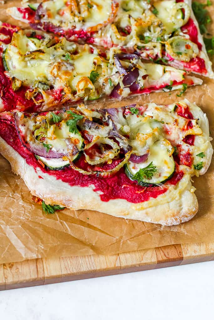 straight on shot of a slice of the beet pesto pizza