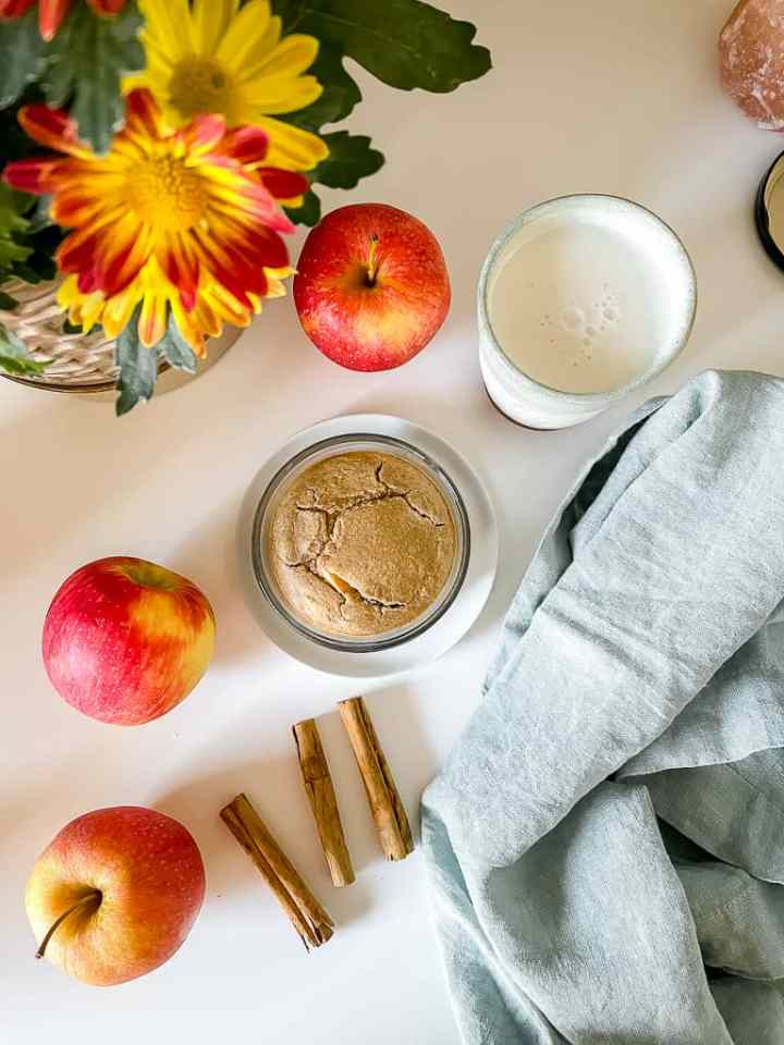 overhead photo of the blended baked oats on a white table with apples around it