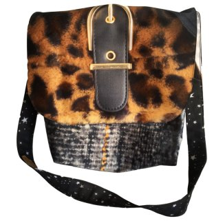 Leopard print upcycled billboard messanger hand bag made from waste by communities