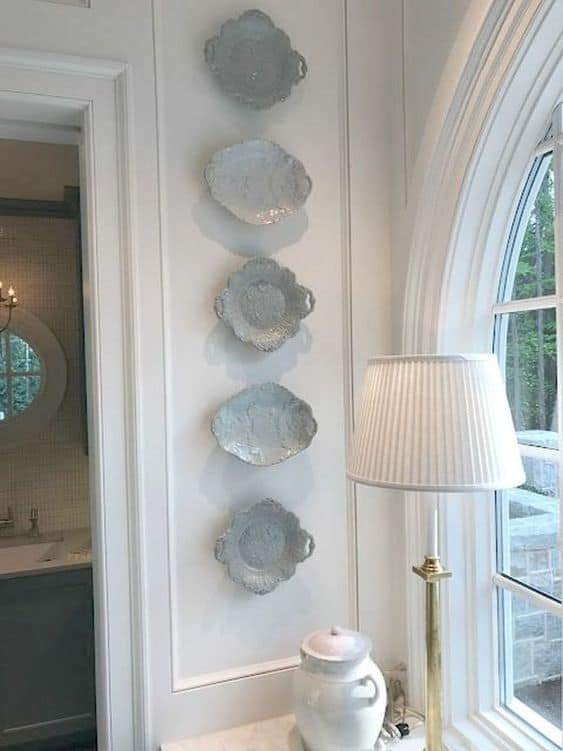 upcycled grey plates hung horizontally