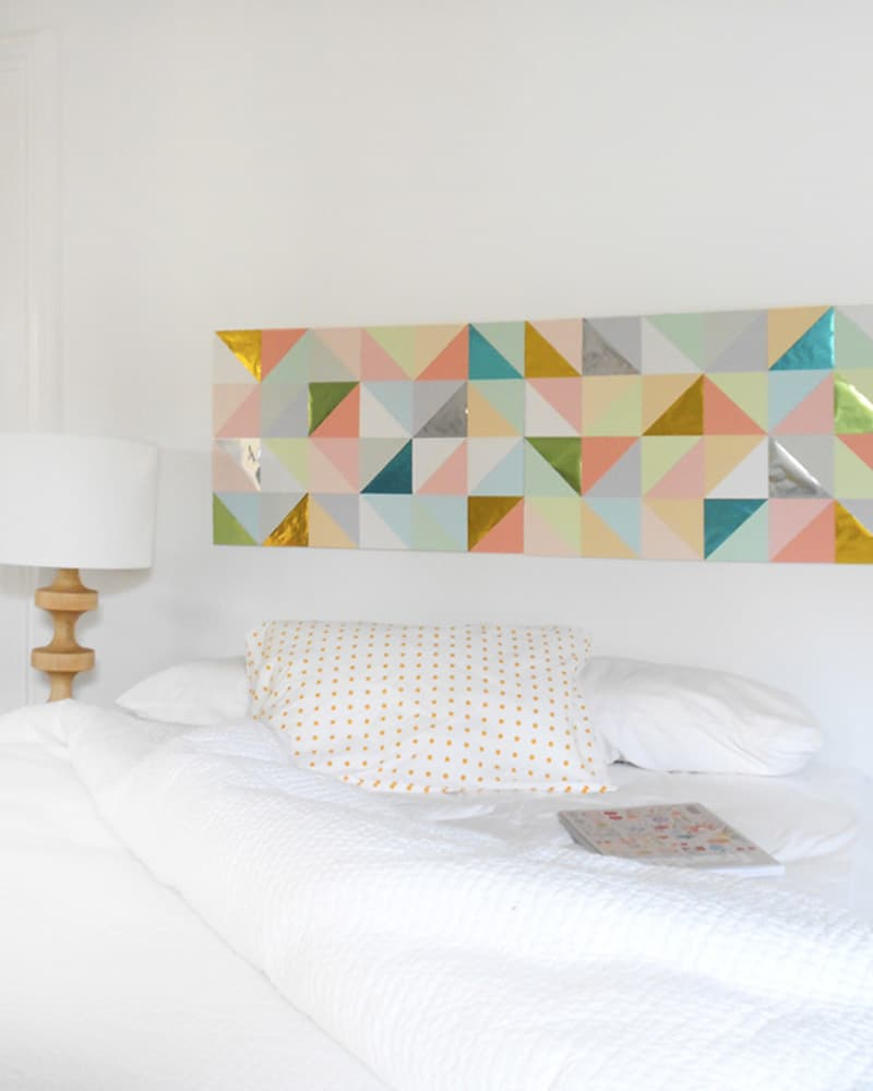 paper triangle headboard to fill a blank wall