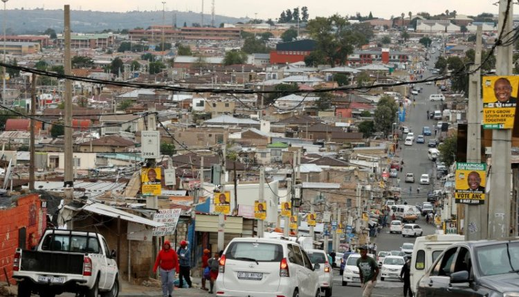 African National Congress (ANC) election posters are seen on street poles in Alexandra township