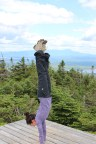 I tend to do some sort of yoga pose when I climb a mountain. In the distance to the right you can see the peak of Mt. Katahdin, the summit of the Appalachian Trail