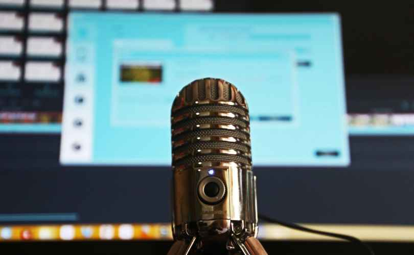 selective focus photography of gray stainless steel condenser microphone