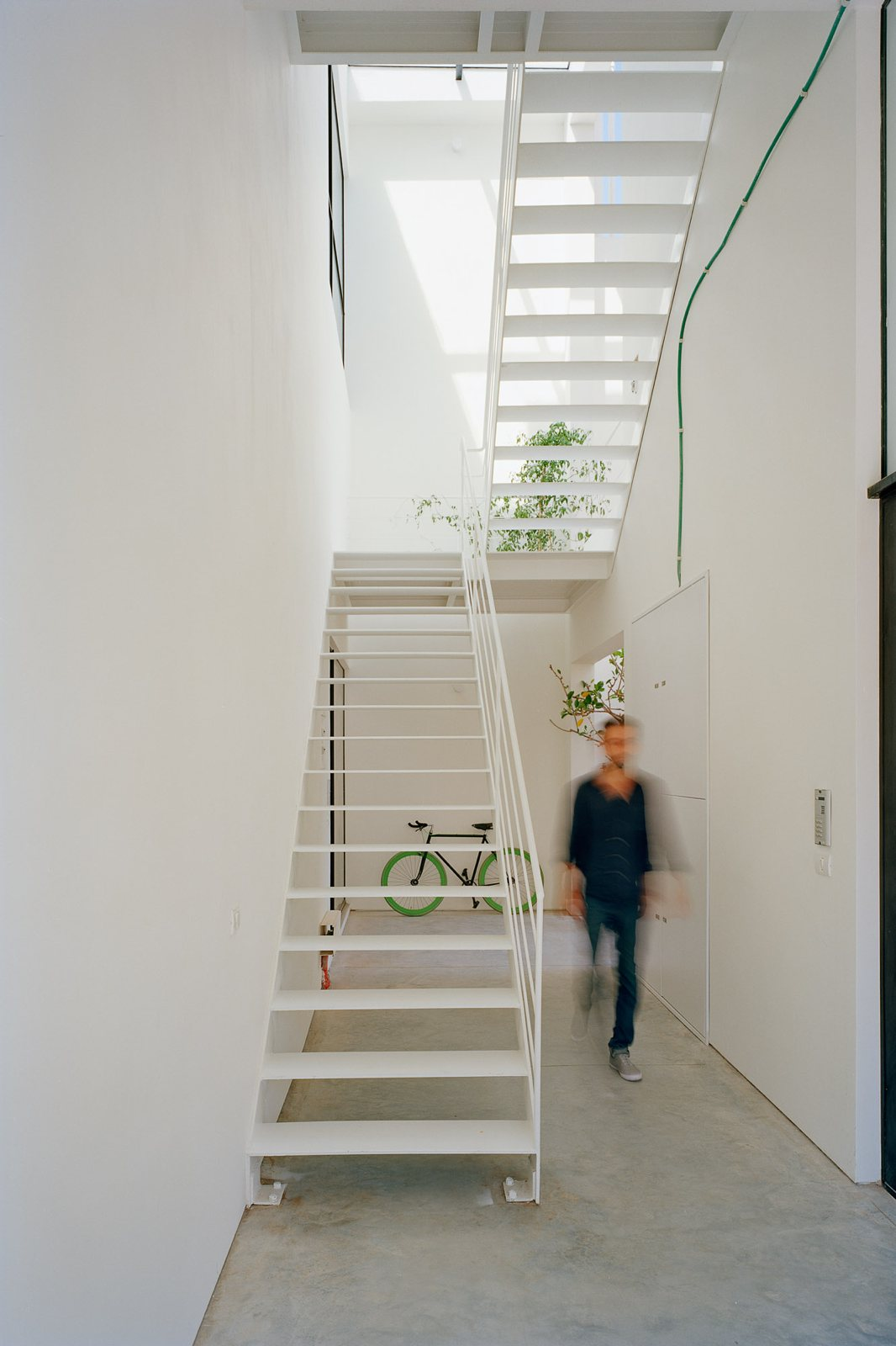 White metal staircase Apartment building by AN  UP interiors