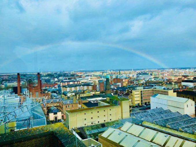 Rainbow sets in the background of the Guinness Storehouse in Historic Dublin, Ireland.