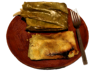 tamales on a wooden plate
